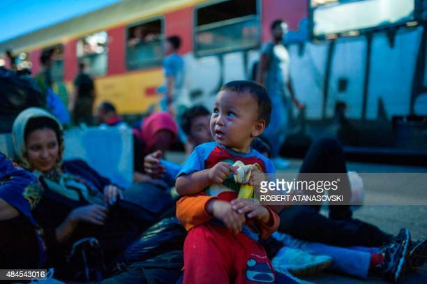 Migrants wait for a train to Serbia in the town of Gevgelija on the MacedonianGreek border on August 19 2015 The migrants among them children and...