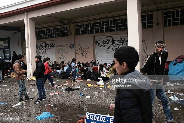 Migrants wait in the port for a ferry on the island of Lesbos on October 22 2015 in Mytilene Greece Dozens of rafts and boats are still making the...