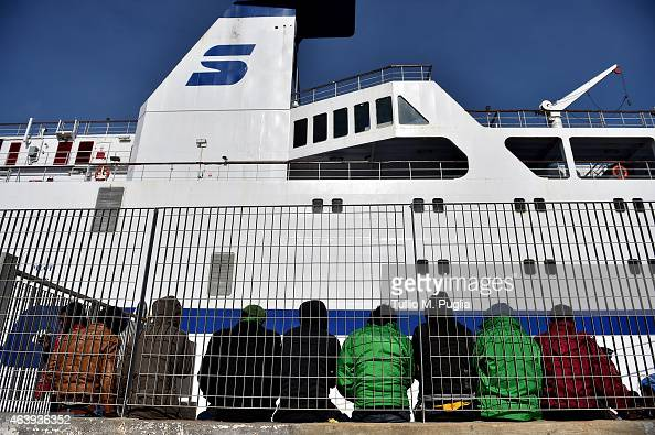 Migrants wait to board a ship on February 20 2015 in Lampedusa Italy Hundreds of migrants recently arrived in Lampedusa after fleeing the attacks by...