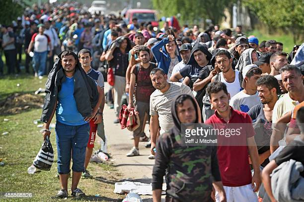 Migrants wait to board busses at Tovarnik railway station following crossing from Serbia on September 18 2015 in Tovarnik Croatia Officials are...