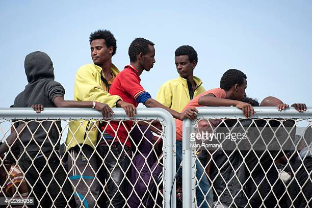 Migrants wait to disembark from military ship 'Bettica' following a rescue operation at sea on May 5 2015 in the port of Salerno southern Italy 653...