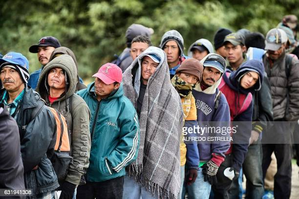 TOPSHOT Migrants wait to receive food donated by people from the Community Center for Migrant Assistance in the community of Caborca in Sonora state...