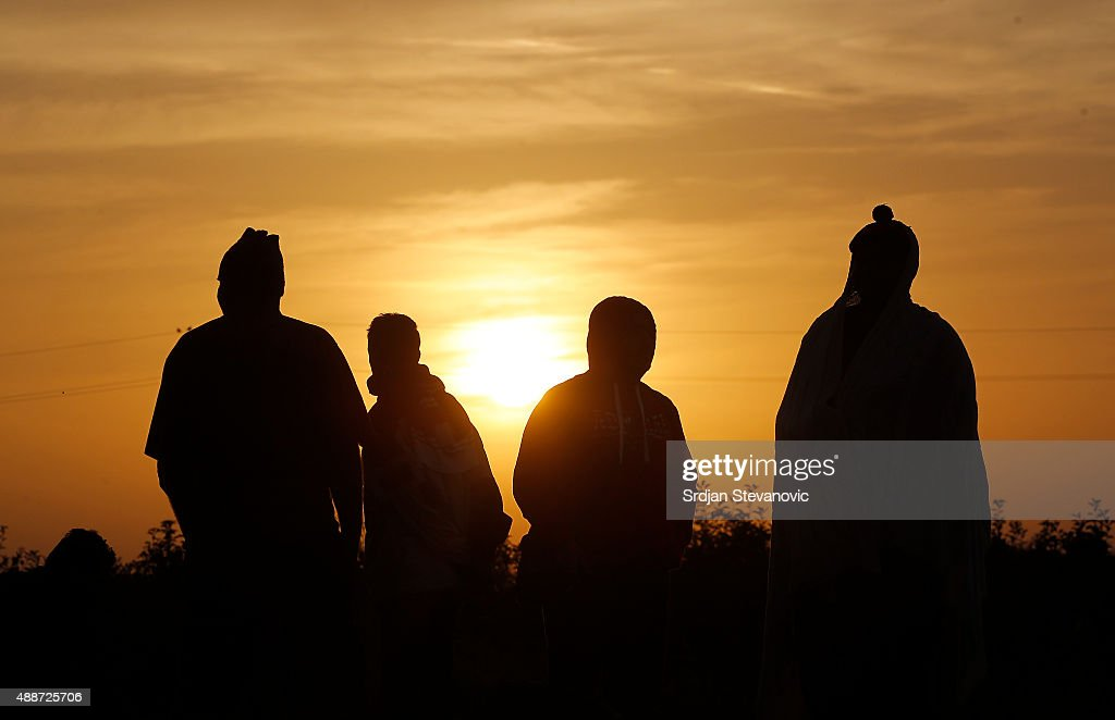 Migrants wake up from their tents to a more peaceful morning after the previous day's friction at the border crossings on September 17 2015 in Horgos...