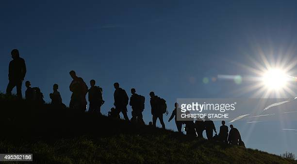 Migrants walk to a first registration point of the German federal police after they crossed the AustrianGerman border in the small Bavarian village...
