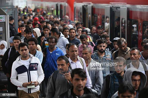 Migrants who had arrived from Hungary arrive to be led by police to a registration center on September 6 2015 in Munich Germany Over 10000 migrants...