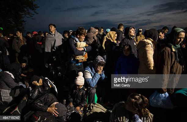 Migrants who have arrived from Greece wait outside a refugee reception centre on October 28 2015 in Gevgelija Macedonia Despite growing concerns...