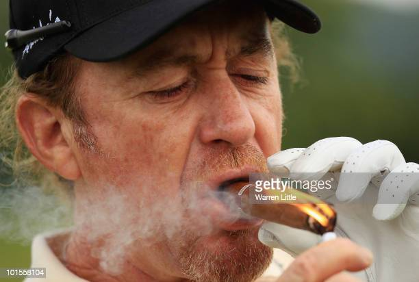 Miguael Angel Jimenez of Spain lights up a cigar on the second tee during the ProAm for the Celtic Manor Wales Open on The Twenty Ten Course on June...