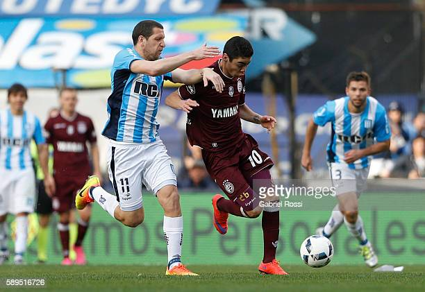 Miguel Almiron of Lanus fights for the ball with Luciano Aued of Racing Club during a match between Racing Club and Lanus as part of Copa del...