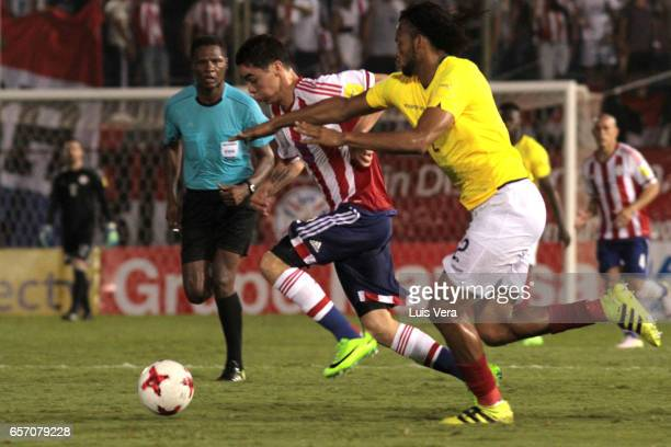 Miguel Almiron of Paraguay and Arturo Mina of Ecuador fight for the ball during a match between Paraguay and Ecuador as part of FIFA 2018 World Cup...