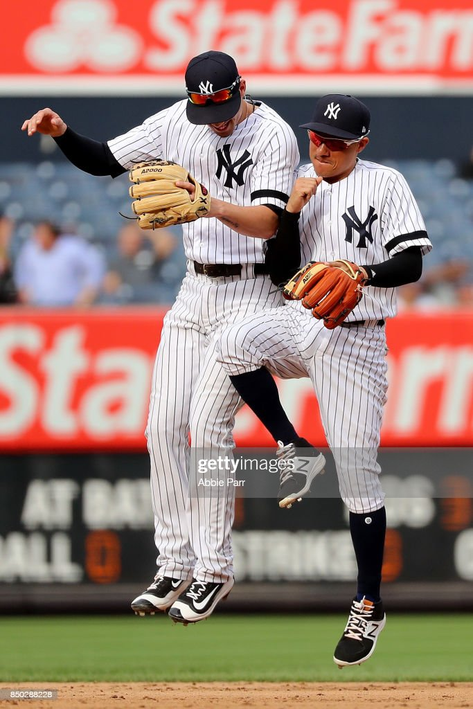 Miguel Andujar #67 of the New York Yankees celebrates with teammate Miguel Andujar #67 of the New York Yankees after an 11-3 win against the Minnesota Twins on September 20, 2017 at Yankee Stadium in the Bronx borough of New York City.