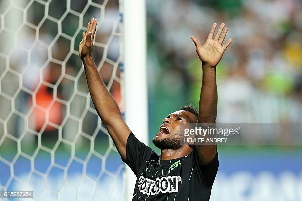 Miguel Angel Borja of Colombia's Atletico Nacional celebrates after scoring against Brazil's Coritiba during a Copa Sudamericana football match at...
