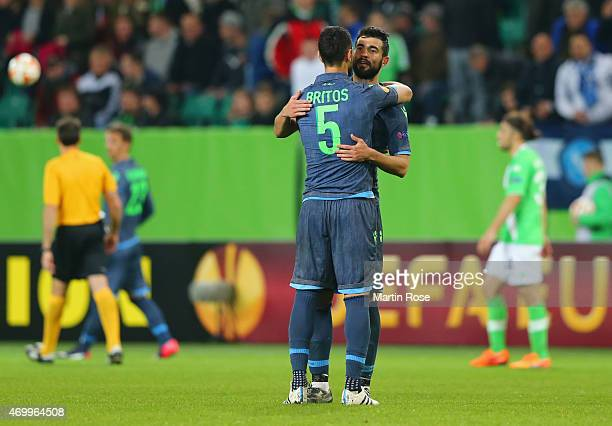 Miguel Angel Britos and Raul Albiol of Napoli celebrate victory after the UEFA Europa League Quarter Final first leg match between VfL Wolfsburg and...