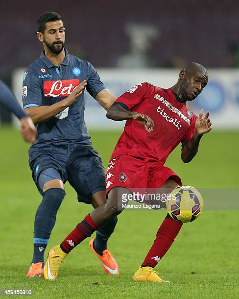 Miguel Angel Britos of Napoli competes for the ball with Victor Ibarbo of Cagliari during the Serie A match between SSC Napoli and Cagliari Calcio at...