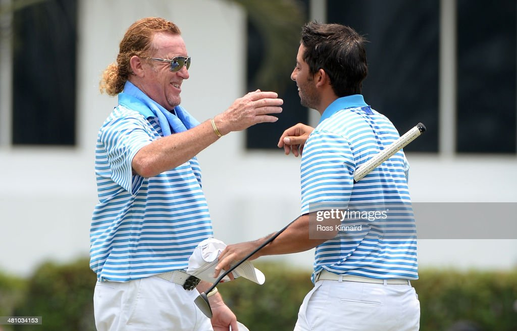 Miguel Angel Jimenez and Pablo Larrazabal of Team Europe celebrate after the foursome matches on day two of the EurAsia Cup at Glenmarie GCC on March...
