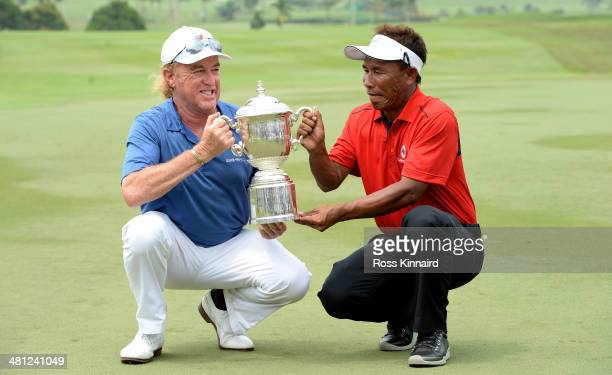 Miguel Angel Jimenez Captain of Team Europe and Thongchai Jaidee Captain of Team Asia are pictured together with the trophy after the first EurAsia...