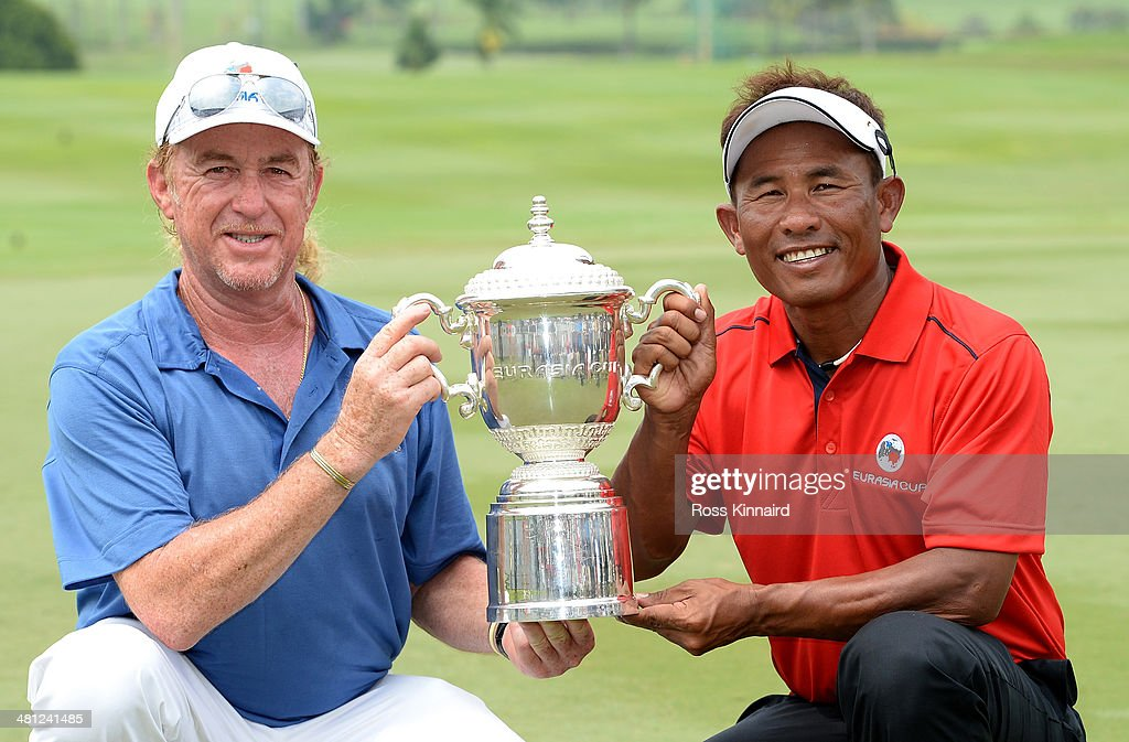 <a gi-track='captionPersonalityLinkClicked' href=/galleries/search?phrase=Miguel+Angel+Jimenez&family=editorial&specificpeople=171700 ng-click='$event.stopPropagation()'>Miguel Angel Jimenez</a>, Captain of Team Europe and <a gi-track='captionPersonalityLinkClicked' href=/galleries/search?phrase=Thongchai+Jaidee&family=editorial&specificpeople=200733 ng-click='$event.stopPropagation()'>Thongchai Jaidee</a>, Captain of Team Asia are pictured together with the trophy after the first EurAsia Cup finished in a tie. They are pictured after the single matches on day three of the EurAsia Cup at Glenmarie G&CC on March 29, 2014 in Kuala Lumpur, Malaysia.