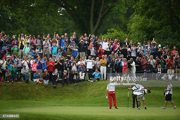 Miguel Angel Jimenez of Spain acknowledges the crowd after his holeinone on the 2nd hole during day 3 of the BMW PGA Championship at Wentworth on May...