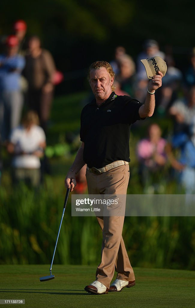 <a gi-track='captionPersonalityLinkClicked' href=/galleries/search?phrase=Miguel+Angel+Jimenez&family=editorial&specificpeople=171700 ng-click='$event.stopPropagation()'>Miguel Angel Jimenez</a> of Spain acknowledges the crowd on the 18th green during the third round of the BMW International Open at Golfclub Munchen Eichenried on June 22, 2013 in Munich, Germany.