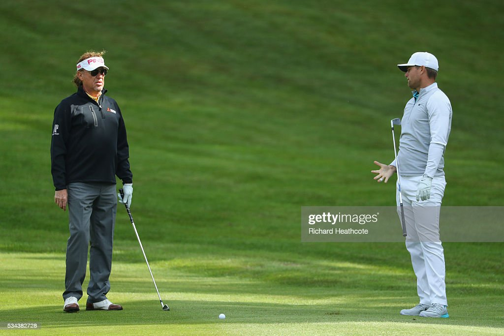 Miguel Angel Jimenez of Spain and <a gi-track='captionPersonalityLinkClicked' href=/galleries/search?phrase=Lucas+Bjerregaard&family=editorial&specificpeople=6215709 ng-click='$event.stopPropagation()'>Lucas Bjerregaard</a> of Denmark react on the 4th green during day one of the BMW PGA Championship at Wentworth on May 26, 2016 in Virginia Water, England.