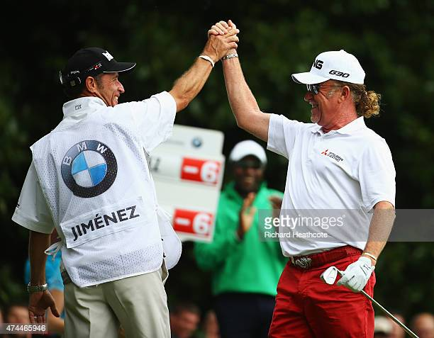 Miguel Angel Jimenez of Spain celebrates his holeinone on the 2nd hole with caddie Cliff Botha during day 3 of the BMW PGA Championship at Wentworth...