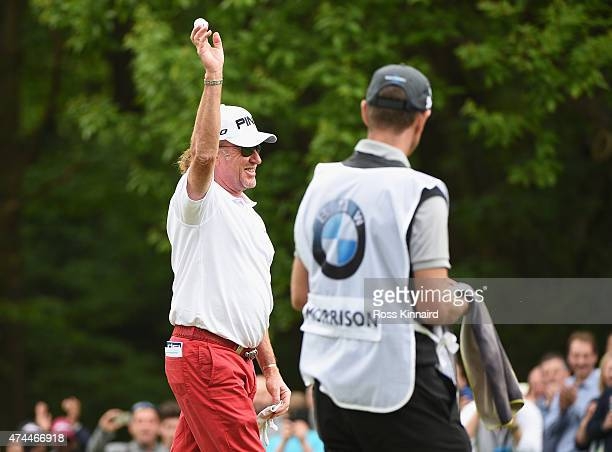 Miguel Angel Jimenez of Spain celebrates his holeinone on the 2nd hole during day 3 of the BMW PGA Championship at Wentworth on May 23 2015 in...