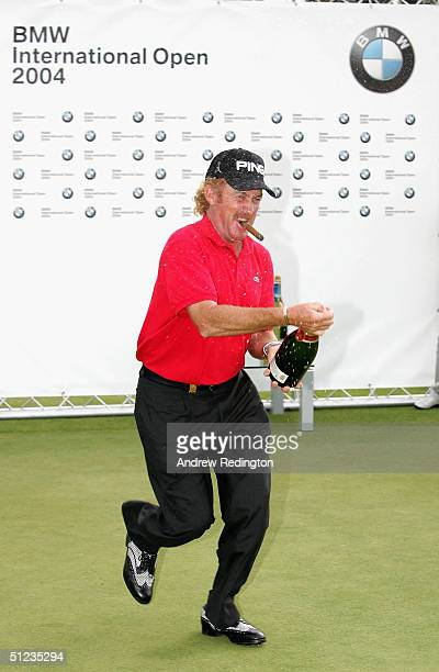 Miguel Angel Jimenez of Spain celebrates his victory with champagne at the BMW International Open at Eichenried Golf Club on August 29 2004 in Munich...