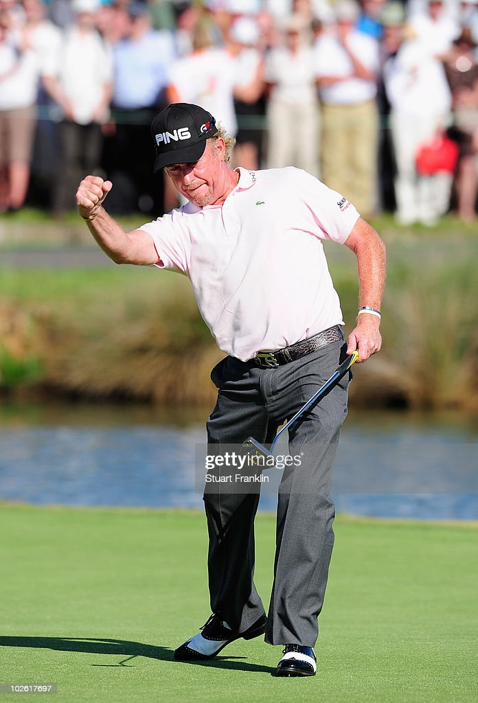 Miguel Angel Jimenez of Spain celebrates holeing the winning putt during the play off on the 18th hole after the final round of the Open de France...