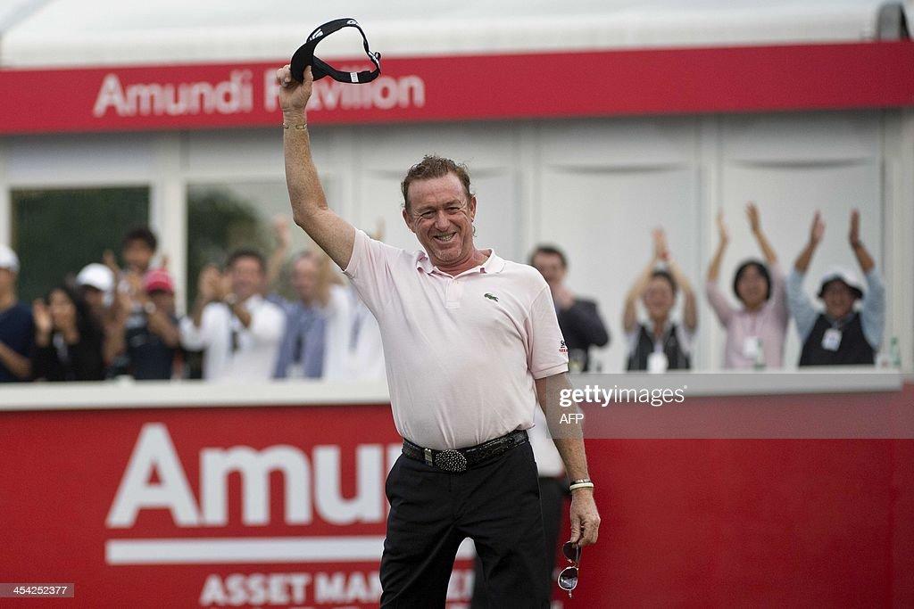 Miguel Angel Jimenez of Spain celebrates winning the Hong Kong Open at the Hong Kong Golf Club in Hong Kong on December 8, 2013.