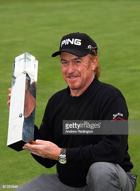Miguel Angel Jimenez of Spain celebrates with the BMW PGA Championship trophy after the 2nd playoff hole on the 18th green during the final day of...