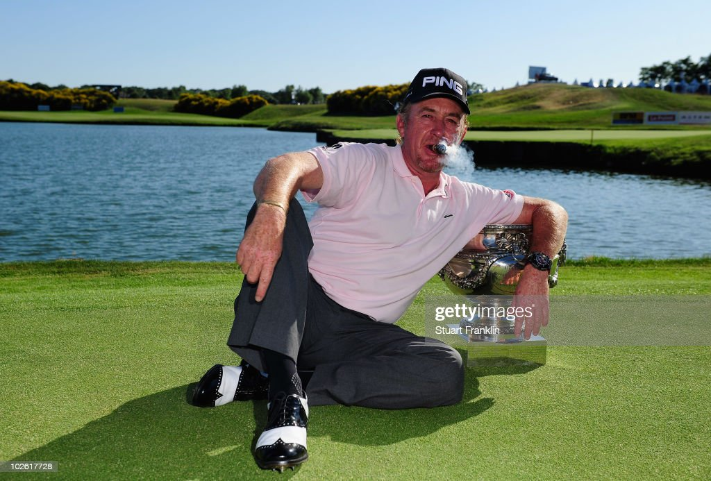 Miguel Angel Jimenez of Spain celebrates with the trophy after winning in a play off on the 18th hole after the final round of the Open de France...