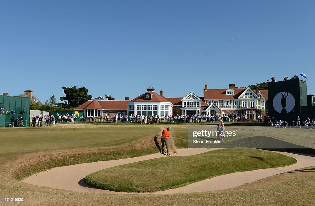 Miguel Angel Jimenez of Spain hits out of the bunker on the 18th hole during the second round of the 142nd Open Championship at Muirfield on July 19...