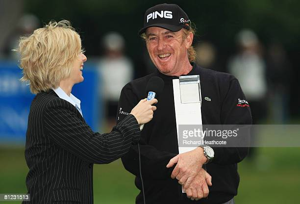 Miguel Angel Jimenez of Spain is interviewed by Hazel Irvine after winning the BMW PGA Championship trophy after the 2nd playoff hole on the 18th...