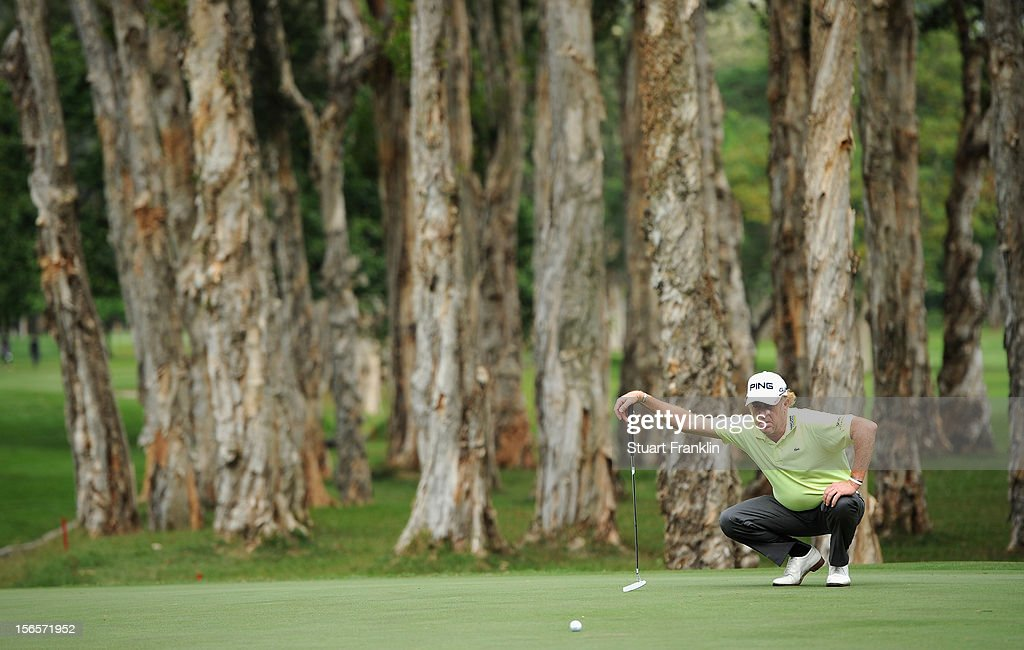 Miguel Angel Jimenez of Spain lines up a putt during the third round of the UBS Hong Kong open at The Hong Kong Golf Club on November 17, 2012 in Hong Kong, Hong Kong.
