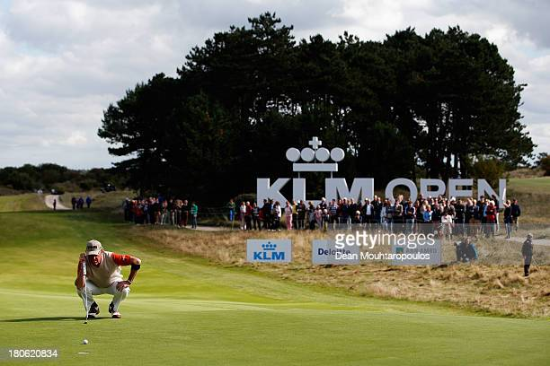 Miguel Angel Jimenez of Spain lines up his putt on the 9th green during the Final Round of the KLM Open at Kennemer G CC on September 15 2013 in...