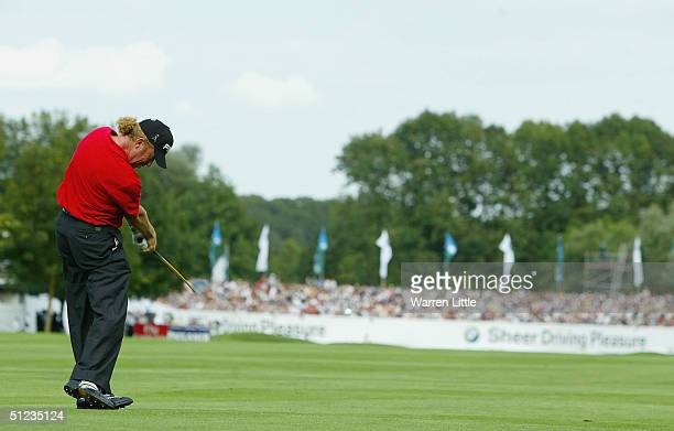 Miguel Angel Jimenez of Spain plays his second shot into the 18th green during the final round of the BMW International Open at Eichenried Golf Club...
