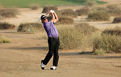 Miguel Angel Jimenez of Spain plays his third shot on the par 5 10th hole during the first round of the 2016 Omega Dubai Desert Classic on the Majlis...