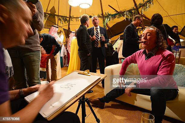 Miguel Angel Jimenez of Spain poses during a cartoon portrait sitting at the Arabian Nights Evening event during the third round of the Dubai Duty...