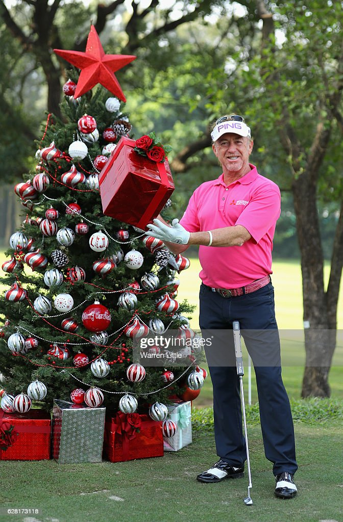 Miguel Angel Jimenez of Spain poses with a present by a Christmas tree during the pro-am ahead of the UBS Hong Kong Open at The Hong Kong Golf Club on December 7, 2016 in Hong Kong, Hong Kong.