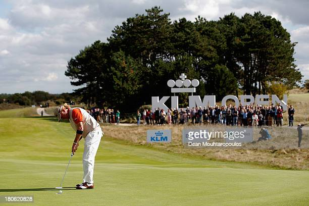 Miguel Angel Jimenez of Spain putts on the 9th green during the Final Round of the KLM Open at Kennemer G CC on September 15 2013 in Zandvoort...