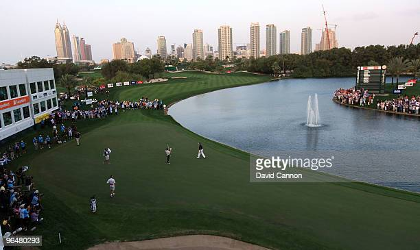 Miguel Angel Jimenez of Spain raises his arms after defeating Lee Westwood of England at the 3rd extra hole the 9th during the sudden death playoff...