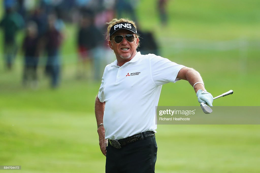 Miguel Angel Jimenez of Spain reacts to his 2nd shot on the 16th hole during day two of the BMW PGA Championship at Wentworth on May 27, 2016 in Virginia Water, England.