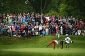Miguel Angel Jimenez of Spain retrieves his ball after his holeinone on the 2nd hole during day 3 of the BMW PGA Championship at Wentworth on May 23...