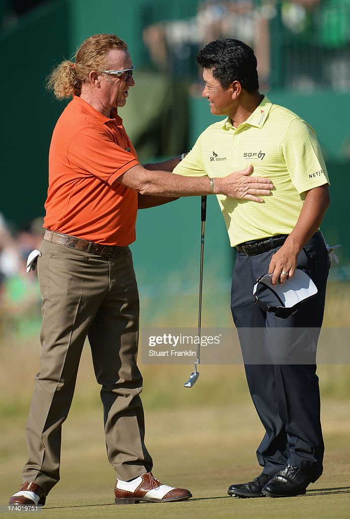 Miguel Angel Jimenez of Spain shakes hands with KJ Choi of Korea after finishing their round in the second round of the 142nd Open Championship at Muirfield on July 19, 2013 in Gullane, Scotland.
