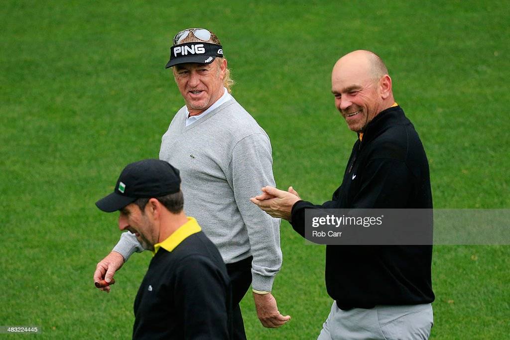 Miguel Angel Jimenez of Spain, Thomas Bjorn of Denmark and Jose Maria Olazabal of Spain walk together during a practice round prior to the start of the 2014 Masters Tournament at Augusta National Golf Club on April 7, 2014 in Augusta, Georgia.