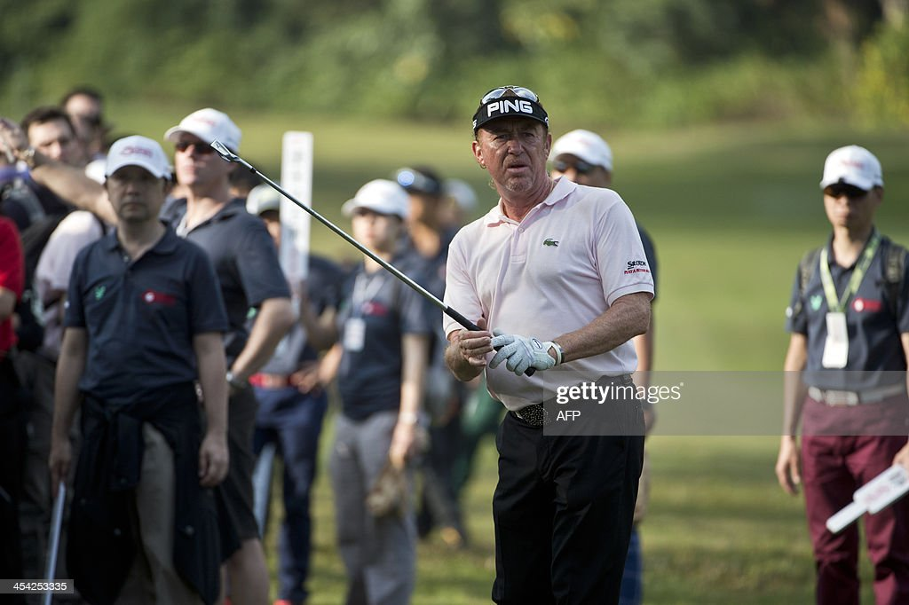 Miguel Angel Jimenez of Spain watches his ball after hitting a shot on the final day of the Hong Kong Open at the Hong Kong Golf Club in Hong Kong on December 8, 2013. Jimenez won the tournament for a record-equalling fourth time.