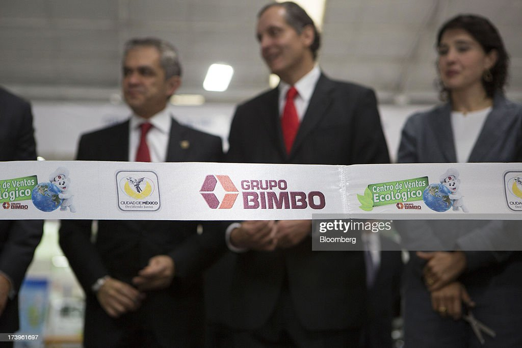 Miguel Angel Mancera, mayor of Mexico City, left, and Daniel Servitje, chief executive officer of Grupo Bimbo SAB de CV, speak before the ribbon cutting ceremony inside the company's new sales center in Mexico City, Mexico, on Thursday, July 18, 2013. Grupo Bimbo inaugurated a new eco-friendly sales center today. Photographer: Susana Gonzalez/Bloomberg via Getty Images Miguel Angel Mancera; Daniel Servitje