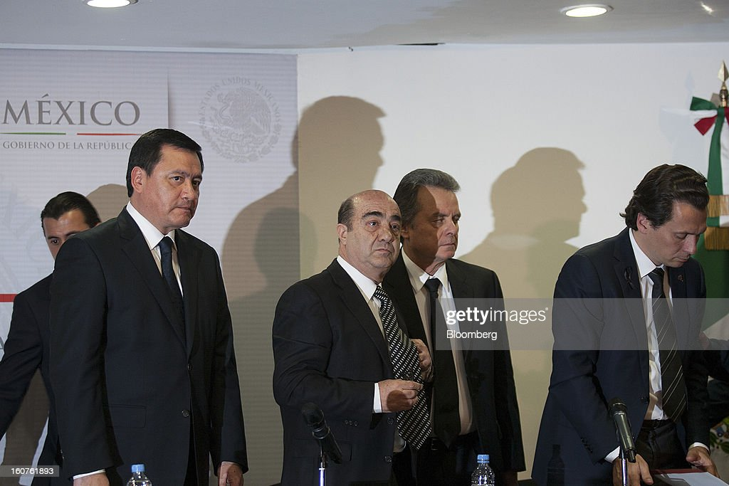 Miguel Angel Osorio Chong, Mexico's minister of the interior, from left, Jesus Murillo Karam, Mexico's attorney general, Pedro Joaquin Coldwell, energy minister, and Emilio Lozoya Austin, chief executive officer of Petroleos Mexicanos (Pemex), prepare to depart following a news conference in Mexico City, Mexico, on Monday, Feb. 4, 2013. The blast that killed 37 people at state-owned oil company Petroleos Mexicanos's headquarters in Mexico City last week was caused by gas buildup, Murillo said, the first government explanation for the nation's deadliest explosion since 2006. Photographer: Susana Gonzalez/Bloomberg via Getty Images