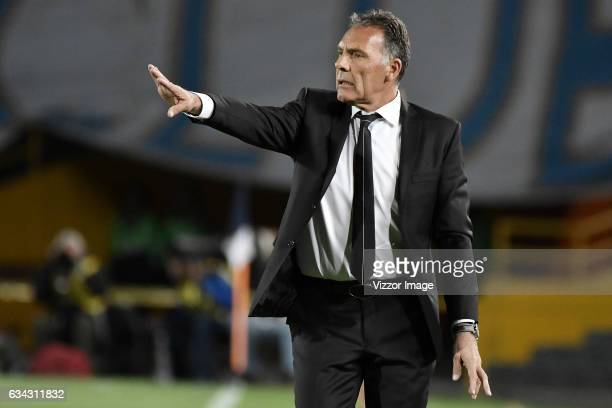 Miguel Angel Russo coach of Millonarios gives instructions to his players during a match between Millonarios and Atletico Paranaense as part of Copa...