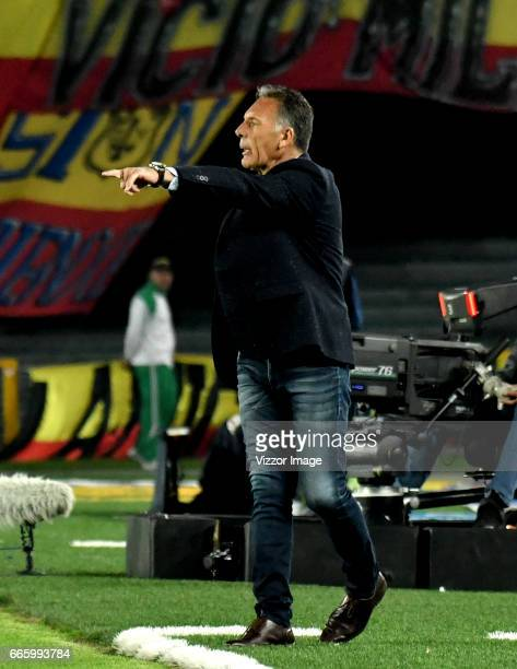 Miguel Angel Russo coach of Millonarios gives instructions to his players during the match between Millonarios and Atletico Nacional as part of the...