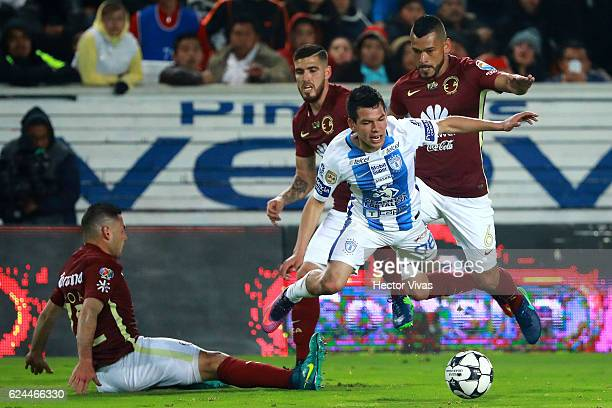 Miguel Angel Samudio and Pablo Aguilar of America struggles for the ball with Hirving Lozano of Pachuca during the 17th round match between Pachuca...